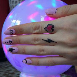 Finger tattoo of Yana Migami #Pixelstyle #pixel #fingertattoo #YanaMigami #lightning #heart #symbols