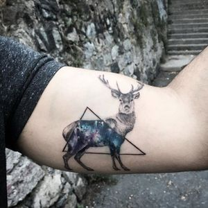 Deer galaxy tattoo by Resul Odabaș. #ResulOdabas #dotwork #cosmic #cosmos #deer #triangle #animal