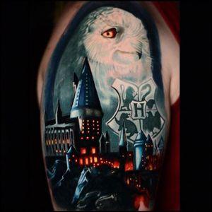Hogwarts tattoo by Ben Ochoa. #BenOchoa #colorrealism #owl #HarryPotter #hogwarts #castle #popculture #film