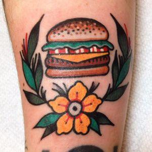 A delicious looking hamburger alongside a flow by Mike Suarez (IG— suarezism). #flower #hamburger #MikeSuarez #traditional