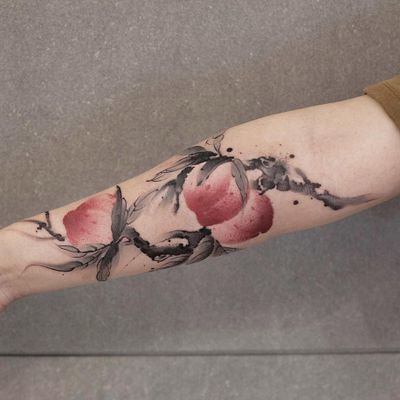 Peach tattoo by Chenjie.newtattoo #chenjienewtattoo #besttattoos #color #blackandgrey #Chinese #painting #illustrative #watercolor #peaches #peach #fruit #foodtattoo #fruittattoo #leaves #branch #nature