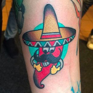 A really awesome looking chili wearing a sombrero. Magnificent tattoo by Luca Sala. #LucaSala #OldInkTattoo #boldtattoos #solidtattoos #chili #sombrero #mustache