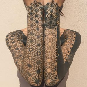 Geometric sleeve tattoos by Kenji Alucky, photo from Kenji's Instagram @black_ink_power #geometric #blackwork #tribal #patternwork #dotwork