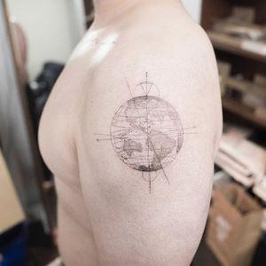 A globe with longitudinal and latitudinal lines via Hongdam (IG—ilwolhongdam). #blackandgrey #fineline #globe #Hongdam #microtattoo #miniature #realism