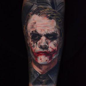 The Joker tattoo by Ben Ochoa. #BenOchoa #colorrealism #popculture #thejoker #joker #dc #villain #heathledger