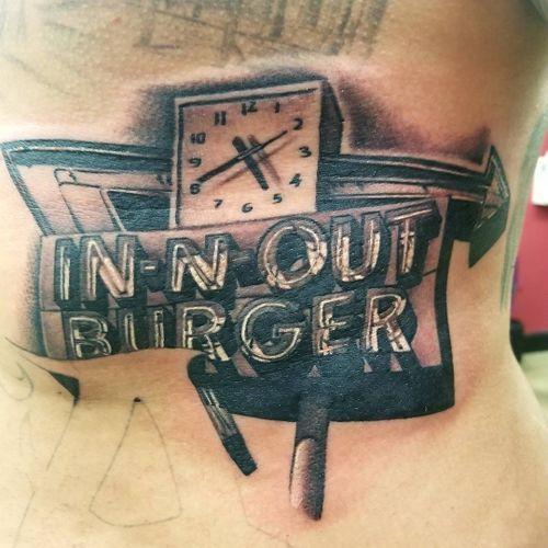 Burger sign tattoo by Tommy Montoya #TommyMontoya #blackandgrey #realism #realistic #hyperrealism #clock #sign #burger #innout #food #foodtattoo