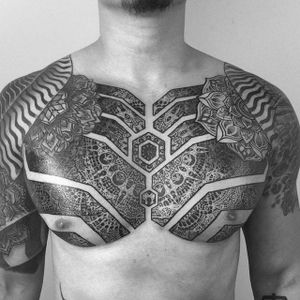 An intensely ornate chest piece with two mandalas by Piotr Szot (IG—piotrszot). #blackwork #PiotrSzot #scaredgeometry