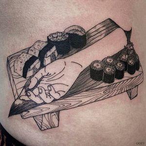 Bon Appetit! Sushi and hand Tattoo by Oozy @Oozy_Tattoo #Oozy #OozyTattoo #Blackwork #Black #Linework #OddTattoos #Korea #sushi #maki #hand