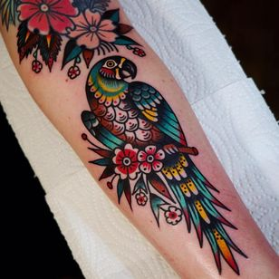 Pretty parrot tattoo by Electric Martina #ElectricMartina #besttattoos #color #newtraditional #folktraditional #traditional #mashup #parrot #bird #feathers #tropical #flowers #leaves #nature #tattoooftheday