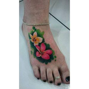 Vibrant Frangipani Foot Tattoo by @paudy_tattoos #frangipani #plumeria #vibrant #color #paudy_tattoos #flower