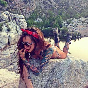 Rockin a bikini in boots LA style image from Pony Wave on Instagram #PonyWave #model #tattooedlady #illustrator #singer #LAtattooer #vegan  #sullenartcollective #sullenangel