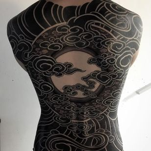 Blackwork tattoo by Gakkin #Gakkin #besttattoos #blackwork #backpiece #sun #moon #clouds #pattern #darkart #geometric #circles #tattoooftheday