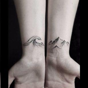 Matching tattoos by Stella Luo #StellaLuo #fineline #blackandgrey #linework #small #matching #wave #mountain