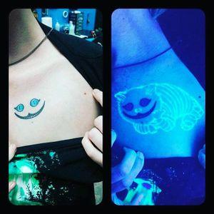 Cheshire cat tattoo, artist unknown.  #cheshirecat #aliceinwonderland #uv #blacklight