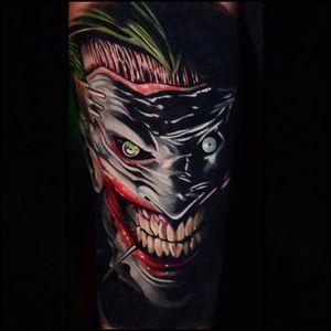 The Joker tattoo by Ben Ochoa. #BenOchoa #colorrealism #popculture #thejoker #joker #dc #graphicnovel #psycho