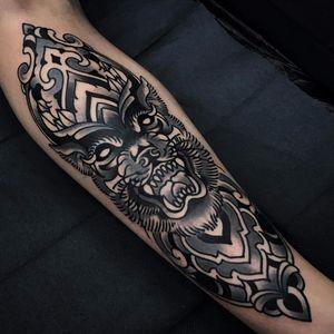 Protective design by Paul O'Rourke #paulorourke #lion #tiger #wolf #blackwork #blackandgrey #ornamental #pattern #scroll #tattoooftheday