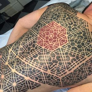 Bold dotwork back-piece with red ink center by Mould. #backpiece #geometric #NathanMould #ornamental #stippled #dotwork