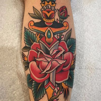 A rose for a rose by Chris Stuart #ChrisStuart #neotraditional #traditional #color #rose #sword #knife #flowers #leaves #nature #rosebud #tattoooftheday