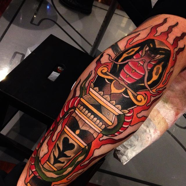 A traditional style snack and torch tattoo by Emmet Jace. #traditional #snake #torch #EmmetJace #TheBlackMark