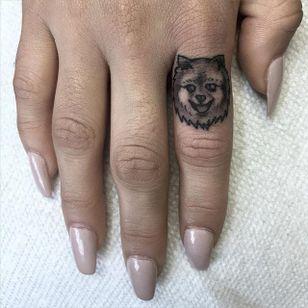 Dainty fineline pomeranian finger tattoo by Sean Arnold. #dog #pomeranian #fineline #finger #SeanArnold