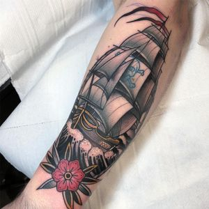 Pirate ship at sea. Tattoo by Jean Le Roux #JeanLeRoux #sailortattoos #color #blackandgrey #traditional #realism #neotraditional #mashup #ship #pirateship #skullandcrossbones #flower #waves #ocean #pirate