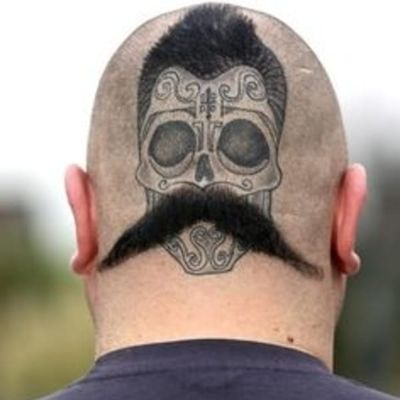 Talk about having eyes in the back of your head. We really admire the extra commitment to the bit. #sugarskull #moustache