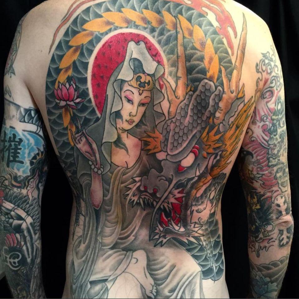 A nearly finished backpiece of a dragon and Amaterasu by John Reardon (IG—johnreardontattoos). #Amaterasu #dragon #Japanese #JohnReardon #largescale