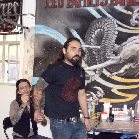 Filip Leu works on the arm of Joao Bosco - London, 2007. #FilipLeu #JoaoBosco #tattoomaster #tattooartist