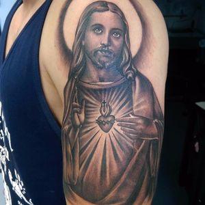 Sacred Heart Jesus by Tommy Montoya #TommyMontoya #blackandgrey #realism #realistic #Jesus #religious #sacredheart #heart #cross #halo #holy #fire #light #tattoooftheday