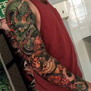 Dragon and tiger brawl, by Joe Frost. (via IG—hellomynamesjoe) #neotraditional #sleeve #joefrost #colorbomb