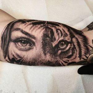 A surreal mix of a woman's and tiger's faces by Nathan Hebert (IG—nathanhebert). #blackandgrey #lady #NathanHebert #realism #tiger