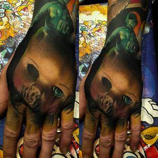 Creepy yet amazing hand tattoo by Craig Cardwell. #CraigCardwell #surreal #painterly #handtattoo #dollhead