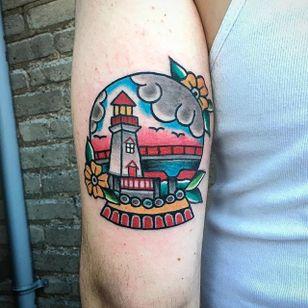 Lighthouse in a snow globe tattoo by Matt Vanasse. #snowglobe #glass #lighthouse