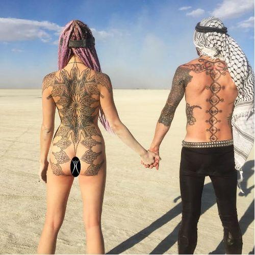#relationshipgoals! Tattooist Kenji Alucky, photo from Kenji's Instagram @black_ink_power #tattooedcouple #blackwork #blckwrk #geometry #mandala #backpiece