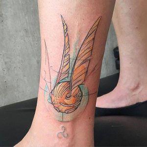Golden snitch tattoo by Mathias Reichert #MathiasReichert #watercolor #graphic #sketchstyle #geek #harrypotter #goldensnitch