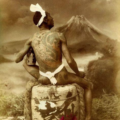 A heavily tattooed man posing for a photo back near the turn of the century. #Irezumi #Japanese #tebori #traditional