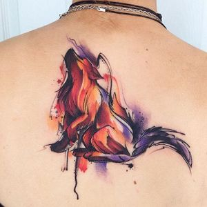 Wolf Tattoo by Adrian Bascur #Watercolor #WatercolorTattoos #WatercolorArtists #BoldWatercolor #BestWatercolor #ModernTattoos #ContemporaryTattoos #AdrianBascur #Wolf #Wolftattoo