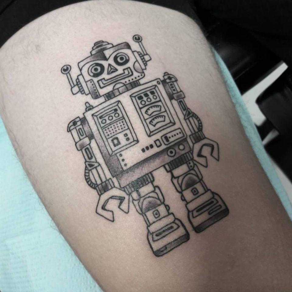 A sweet, but deceitful-looking robot. (via IG - natesorensen_tattooist) #RobotTattoos #Robot #Robots