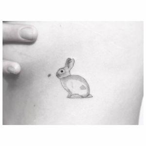 Sweet rabbit tattoo by Jakub Nowicz #fineline #JakubNowicz #blackandgray #blackandgrey #finelineblackandgrey #minimalistic #linework #small #rabbit