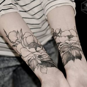 Matching forearm flower tattoos #DianaSeverinenko #floral #flower #blackwork