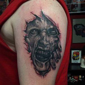 Zombie skin rip tattoo by Shane Murphy. #zombie #horror #skinrip #ShaneMurphy #blackandgrey #realism