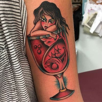 A mermaid basking in a glass of red wine by Sheila Marcello (IG—sheilamarcello). #mermaid #pinups #SheilaMarcello #traditional #wineglass