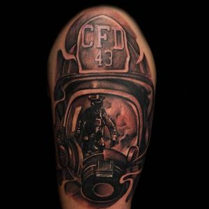 Face front with a cool reflection, by Robert Silva #firefightertattoo #reflection