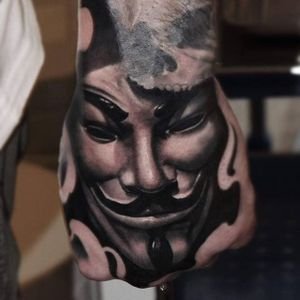 Guy Fawkes mask hand tattoo by Mads Thill. #handtattoo #blackandgrey #anonymous #guyfawkesmask #MadsThill