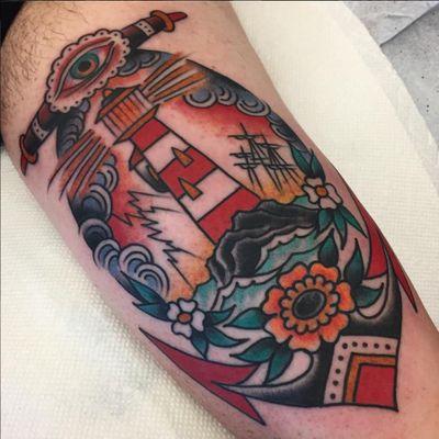 A seascape framed by and anchor by Steve Byrne (IG—steve_byrne_tattoo). #anchor #flower #lighthouse #SteveByrne #traditional