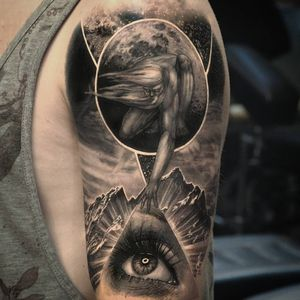 Realistic tattoo by Thomas Wells #ThomasWells #cooltattoos blackandgrey #realism #realistic #hyperrealism #man #portrait #eye #realisticeye #galaxy #stars #mountains #landscape #clouds #space #tattoooftheday