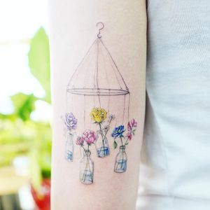 Flower mobile tattoo by Banul #Banul #flowertattoos #linework #realism #realistic #illustrative #mobile #flowers #roses #bottles #water #glass #rosebuds #daisy #peony #floral #nature #tattoooftheday