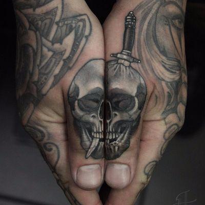 Skull thumbs by Antony Flemming #AntonyFlemming #blackandgrey #newschool #neotraditional #realism #realistic #skull #sword #death #bones #knife #tattoooftheday