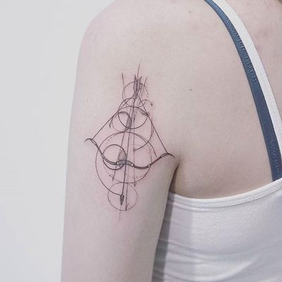 Geometric bow and arrow tattoo by Baam. #Baam #TattooerBaam #subtle #southkorean #fineline #geometric #bow #arrow