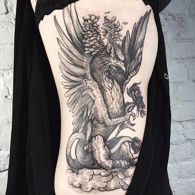 Griffin tattoo by Lesya Kovalchuk. #LesyaKovalchuk #blackwork #mythology #griffin #beast #fantasy